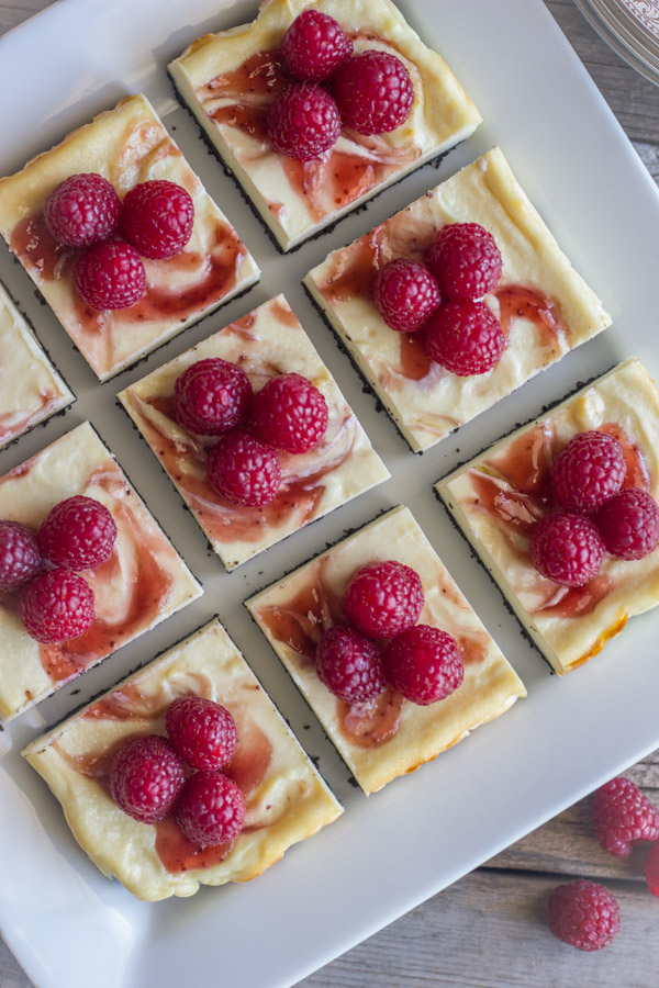 Cute little cheesecake bars with a raspberry swirl and an Oreo crust.