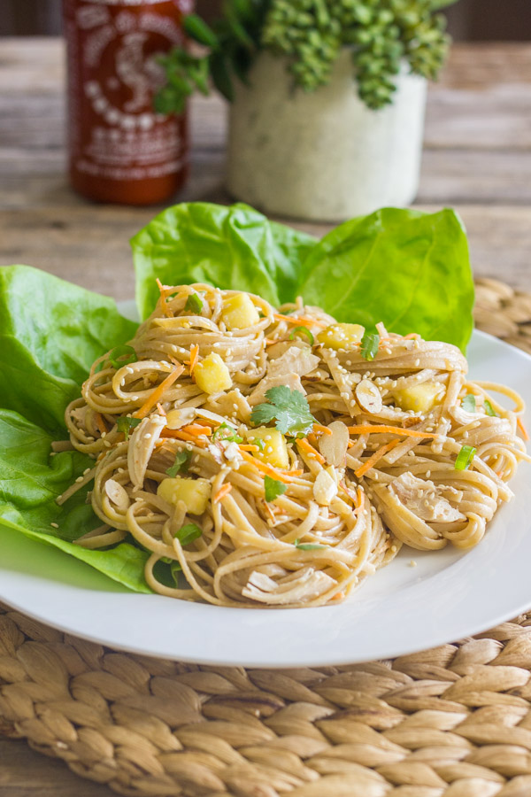 ... almonds, and fresh veggies piled high on a bed of sesame noodles