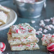 Butter Cracker Peppermint Bark - a thin layer of creamy white chocolate over a buttery, flakey cracker with soft peppermint candies on top.