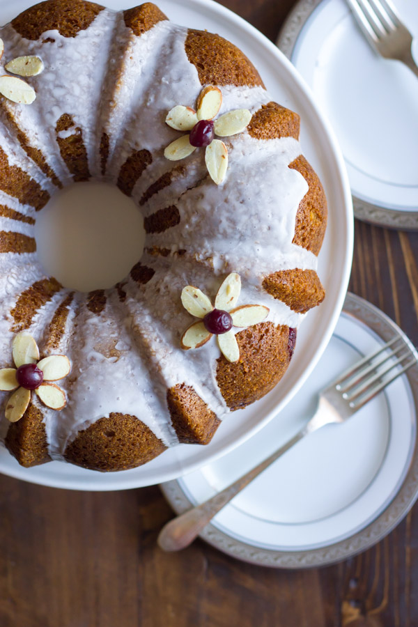 Cranberry Almond Greek Yogurt Cake - Sweet, moist almond cake laced with cranberry sauce and topped with an almond glaze.