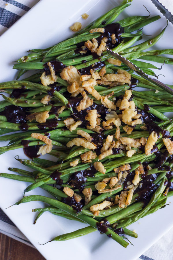 Roasted Green Beans with Creamy Cranberry Balsamic - tangy and sweet fresh green bean side dish topped with french friend onions