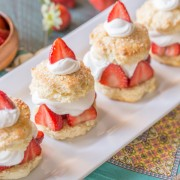 Homemade Strawberry Shortcake - Slightly sweetened fluffy buttermilk biscuits with red ripe strawberries and freshly whipped cream!
