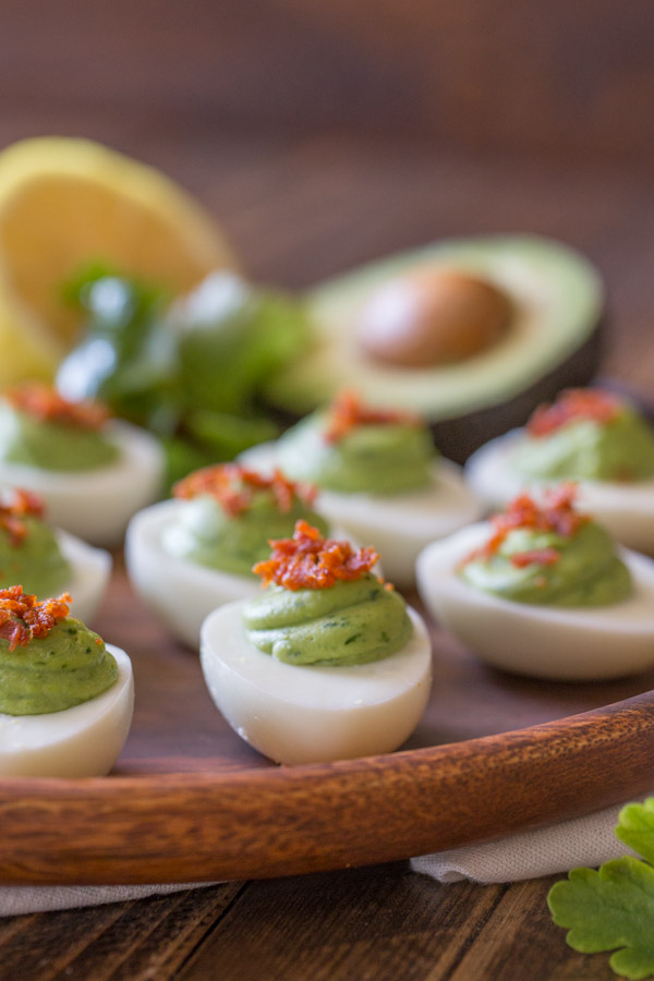 Smoky Bacon Avocado Deviled Eggs - A great way to spice up your traditional Easter menu.