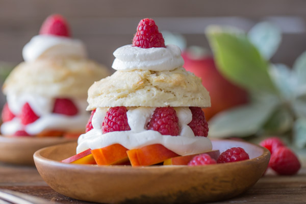 Raspberry Peach Shortcakes - My favorite sweet, buttery, flakey biscuits filled with juicy, ripe peaches, fresh raspberries, and homemade whipped cream.