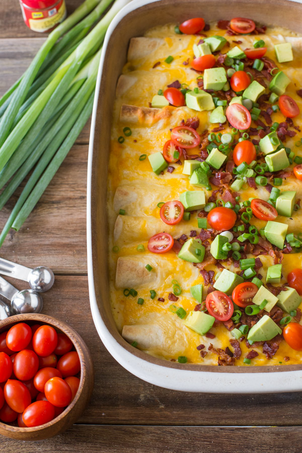 Breakfast Enchilada Bake - A super hearty, ultimate breakfast enchilada bake filled with eggs and cheese that can be served any time of the day.