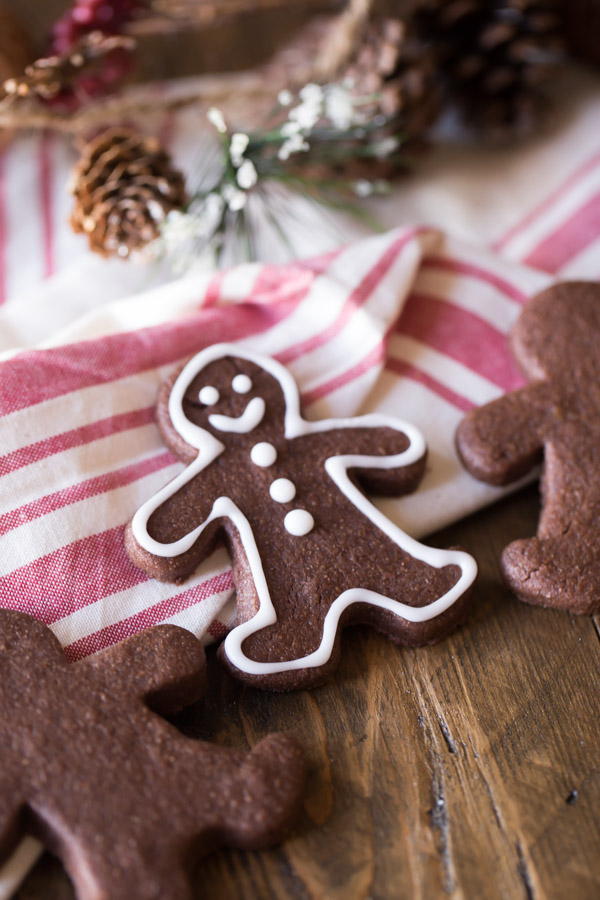 Gingerbread Men Chocolate Cut-Out Cookies decorated with icing.