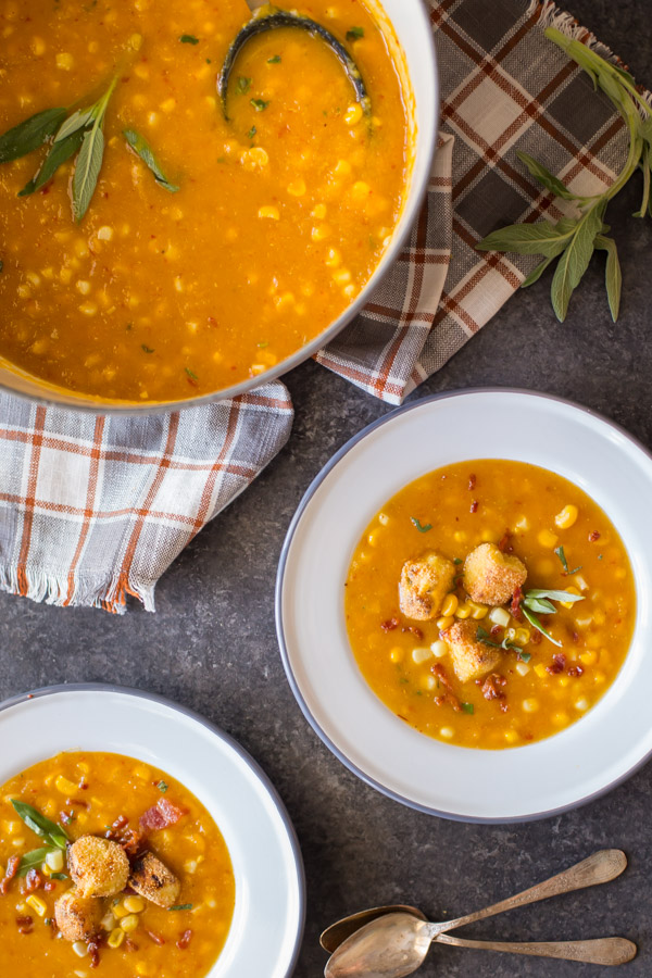 Butternut Squash Corn Chowder With Goat Cheese Croutons - A wonderfully balanced recipe with sweet corn, smokey bacon, chipotle peppers, and creamy goat cheese. Everyone will want to go back for more!