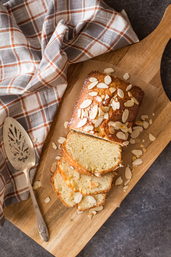 Glazed Almond Poppy Seed Bread - This quick bread is so moist and full of flavor. The orange almond glaze makes it irresistible!