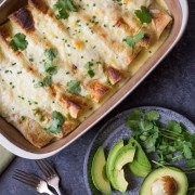 Hatch Green Chile Chicken Enchiladas - Chicken enchiladas with corn and black beans, covered in a creamy Hatch green chile cheese sauce. A quick and easy dinner with just the right amount of heat!