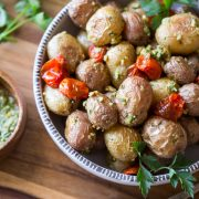 A quick and easy alternative to your typical potato salad, these Roasted Baby Potatoes are tossed with roasted tomatoes and homemade pesto!