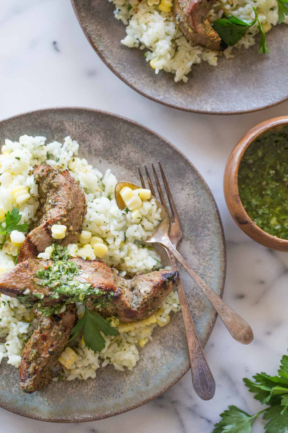 Celebrating all the bold flavors of Brazil with this recipe for marinated flank steak served over chimichurri rice!
