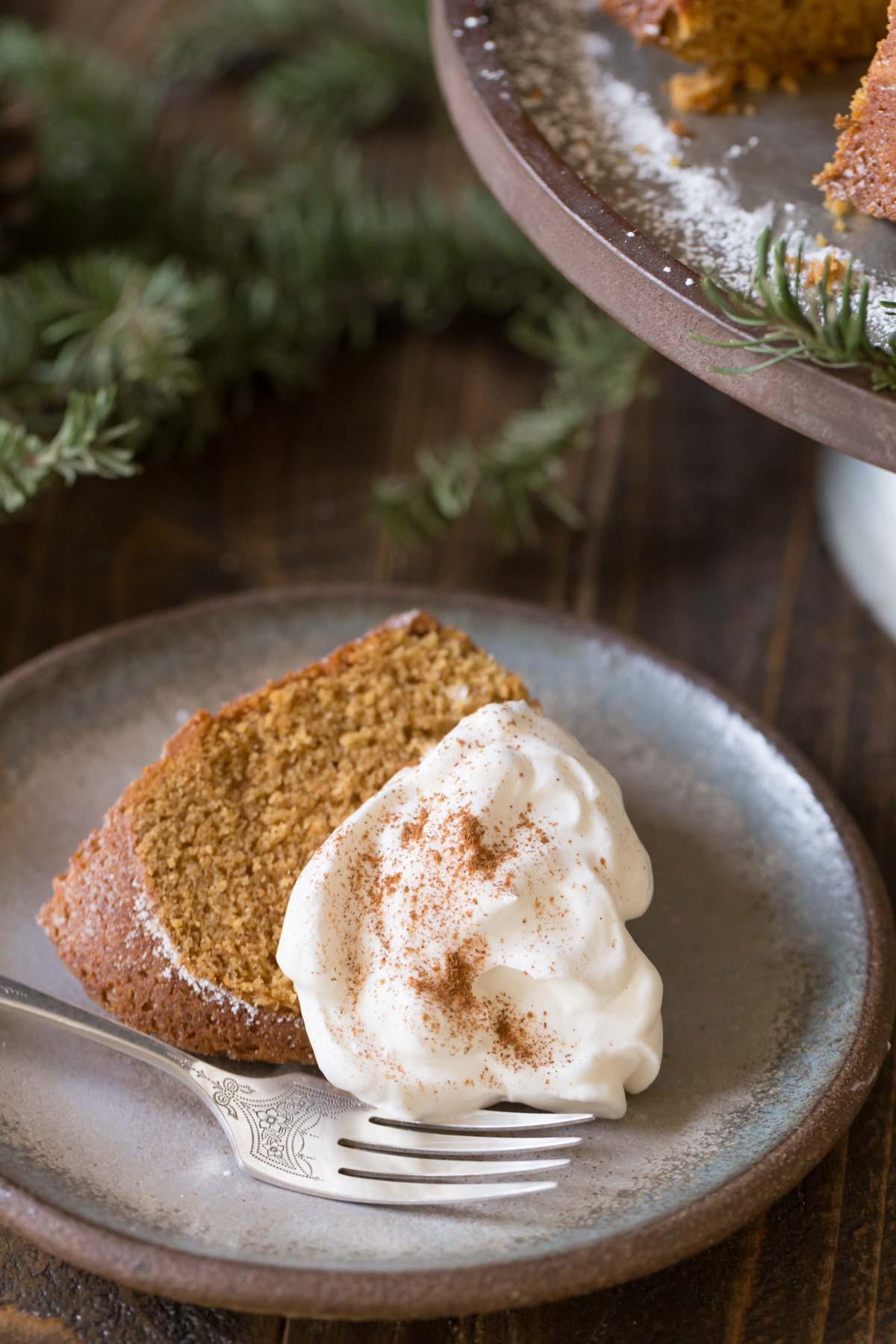 This Gingerbread Bundt Cake has a sweet and tender crumb that is perfectly spiced with cinnamon, ginger and cloves. Freshly whipped and sweetened cream is the perfect topping...