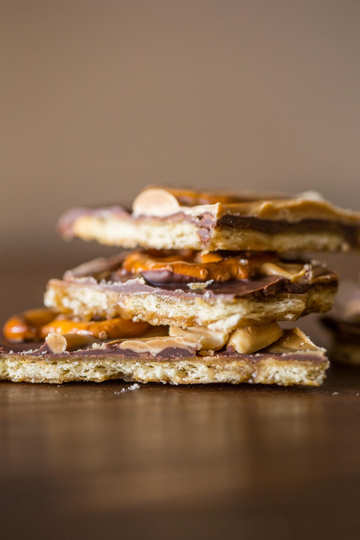 This Take Five Cracker Bark has a butter cracker base with layers of caramel, chocolate, peanut butter, pretzels and peanuts! So delicious and addicting!