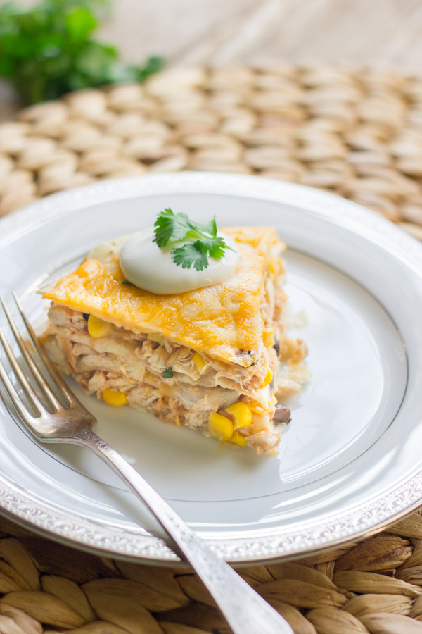 Southwestern chicken taco pie lovely little kitchen southwestern chicken taco pie slice topped with sour cream and cilantro on a plate with forumfinder Choice Image